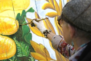 "Susan Cervantes, Painting mural ""Bean Soup,"" on 17th Street"